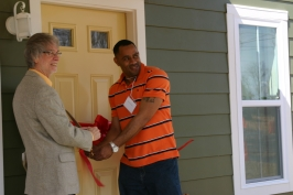 Ribbon cutting homeowner